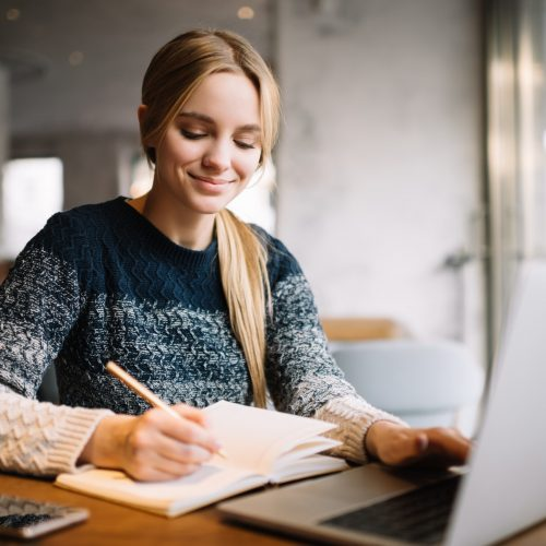 student-studying-using-laptop-computer-online-education-beautiful-woman-freelancer-writes-notes-planning-working-project-working-from-home